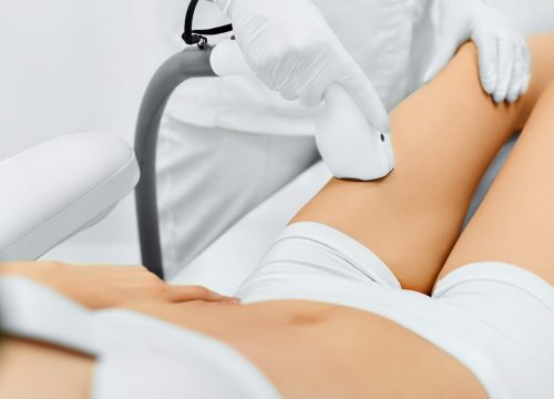 Laser hair removal on woman's leg