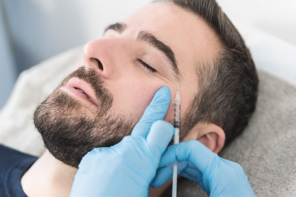 Man receiving a Botox treatment