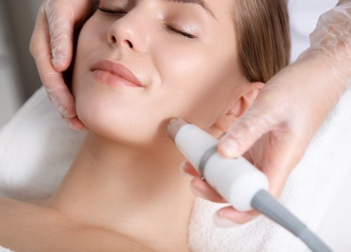 Woman receiving a microdermabrasion treatment
