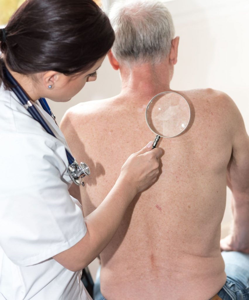 Doctor checking skin of senior patient
