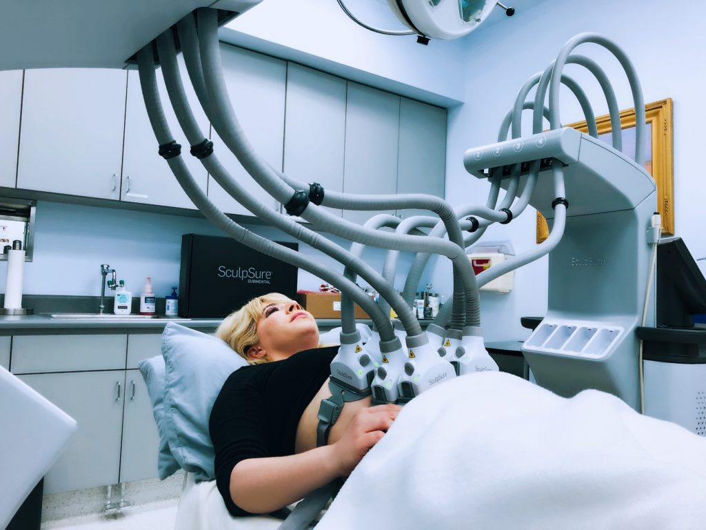 Woman receiving two SculpSure treatments at once